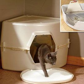Catty Corner Litter Box  Full-size convenience, space-saving design!  Tuck it into a corner...this full-size cat box comes in a space-saving design! The Catty Corner litter box fits even in smaller rooms, but still gives your cat plenty of room to maneuver. Scatter Guard Doorflap keeps spilled litter to a minimum, while the handy sifting tray makes it easy to clean.
