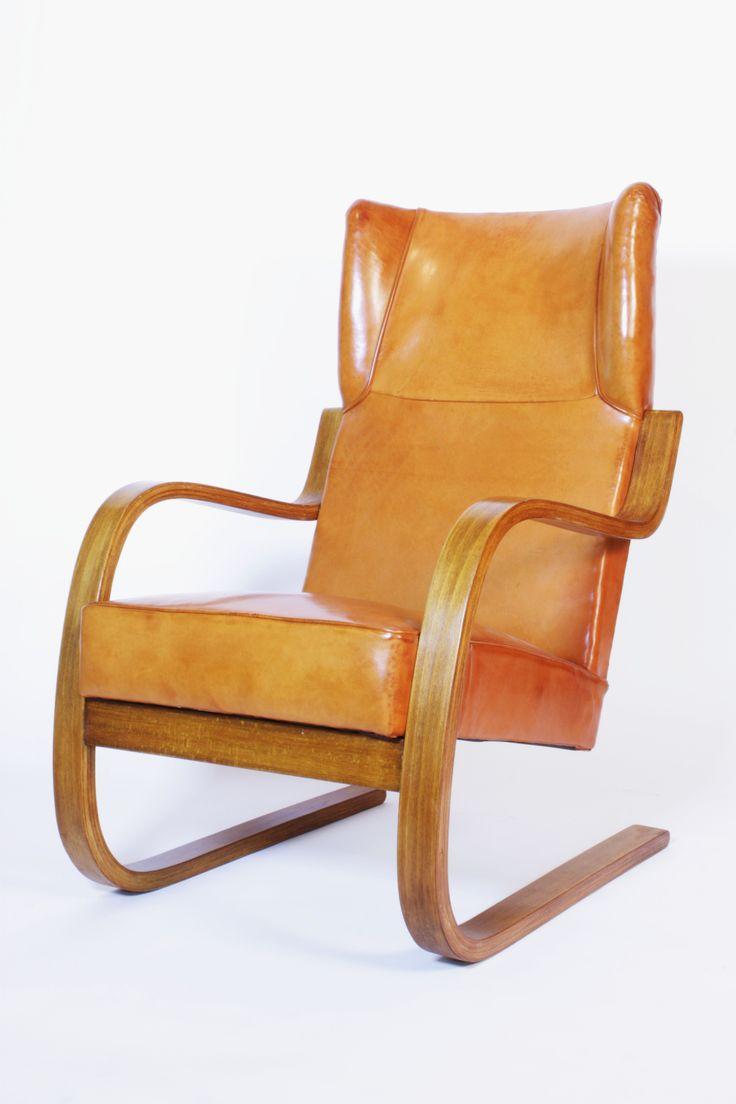 Alvar Aalto; #401 Bent Plywood and Leather Armchair for Artek, c1933.
