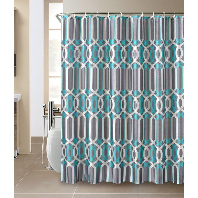 The Plato shower curtain and hook set will add beauty to any contemporary bathroom. It features a geometric vertical wave design in different shades of teal and white on a grey background.