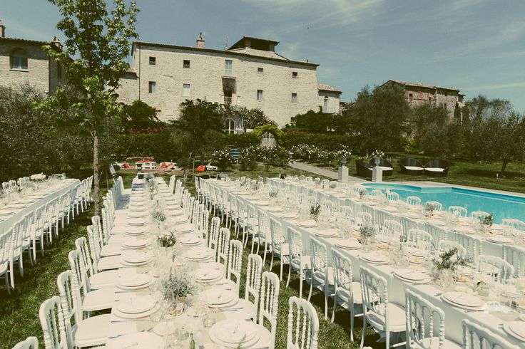 beautiful sunny day, long tables on the grass,  elegant a natural set up with Castello di Montignano as a background!