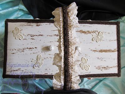 This sewing box was quite tatty and worse for wear when I got it so I gave it a clean and replaced some of the screws then painted the whole thing cream and distressed it when it was dry. Next I added lace butterflies, lace and braided trim (the lace and butterflies were very white so I inked them with antique linen distress ink first).