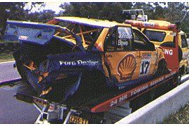 Another Total Destruction On lap 96 Dick Johnson clashed heavily with the Everlast Commodore as he tried to lap it at Tooheys Turn. Bill O'Brien got out of shape at precisely the wrong time, and the two cars came together in the biggest possible way. The Commodore was extensively damaged, the Falcon completely destroyed.