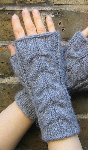 Knitted in softest baby llama, these wristwarmers have mirrored cables on the front, while the palm-side is worked in ribbing and stocking stitch.