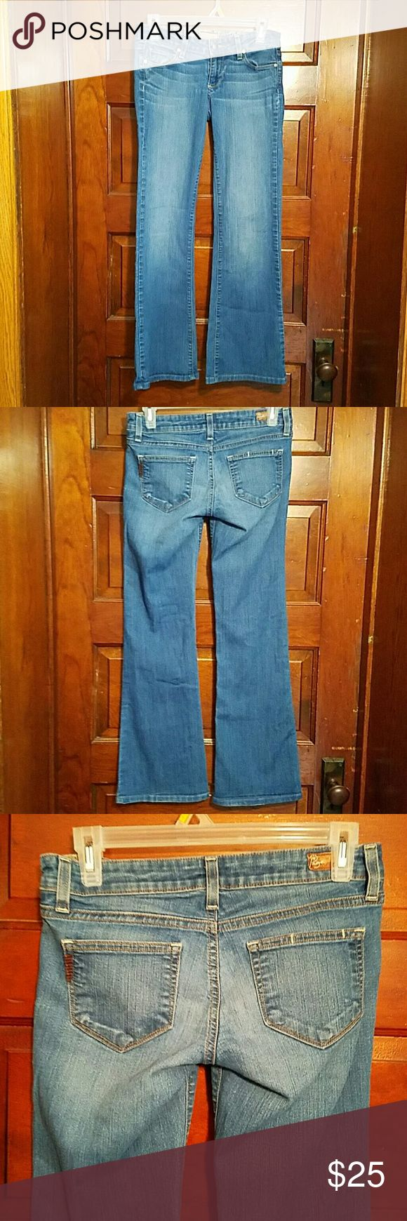 """Paige Canyon Flare Denim Factory Fade Jeans 26 Gently worn women's sexy Flared leg jeans by Paige. Factory whiskering and fade.  Minimal wear to leg openings.  So soft and comfy.  No rips stains or repairs.  From a smoke free home. Five pocket styling.   Measures 27"""" waist,  32"""" hips, 6.5"""" rise,  30"""" inseam. Paige Jeans Jeans Flare & Wide Leg"""