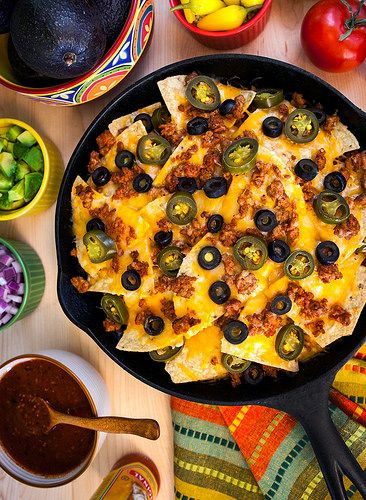 Once you try making nachos in a cast-iron skillet, you may never go back to using a cookie sheet. The cheese gets crispy around the edges, and the skillet retains the oven's heat to help keep the nachos melty and delicious all the way through.