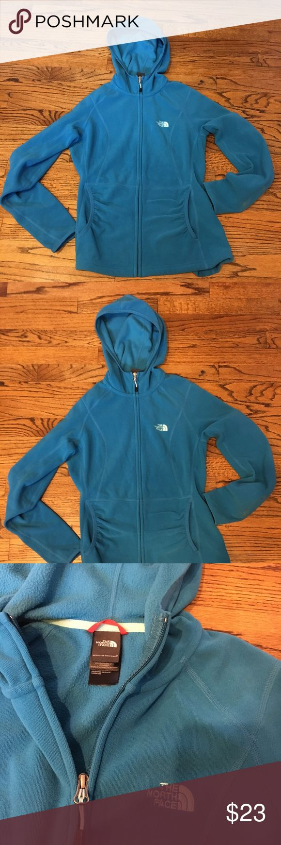 The North Face women's zip up, good condition Amazing color and great condition. Cute style with tigger waist. Light Fleece inside, and sweatshirt like material outside. Front zipper and hood, both in great condition. The North Face Jackets & Coats