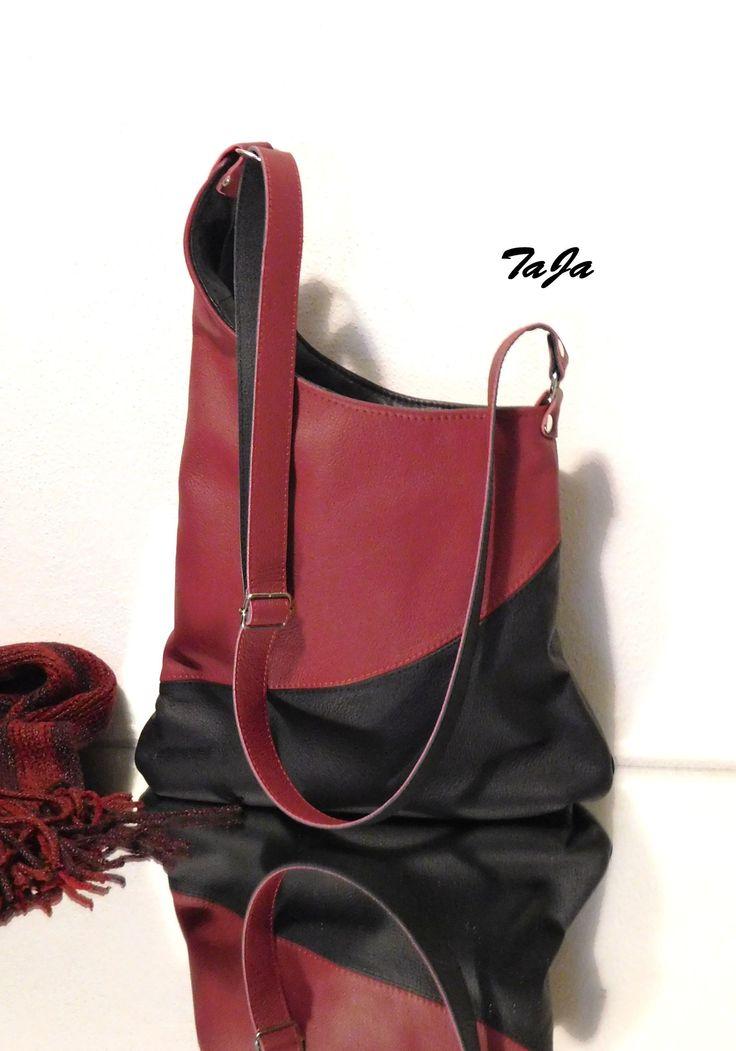Červená+versus+černá+Elegantní,+zajímavá+svými+detaily,+jimiž+je+asymetrické+prodloužení+a+decentní+přerušení+zaobleným+středovým+švem,-+kabelka+v+červeno-černépro+ty,+které+mají+rády+luxusní+originální+doplňky.+Kabelkaje+kožená,+uzavírá+se+na+zip,+uvnitř+podšitá+se+dvěma+kapsičkami,+z+nichž+jedna+je+zipová+Rozměry+-+šíře+nahoře+28cm,+dole+36cm...