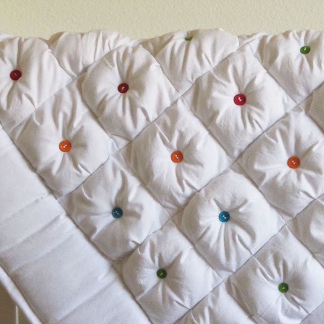 puffy quilt with different color button in each center