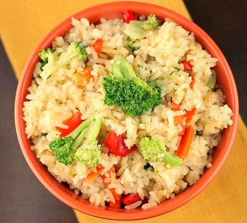 Crock Pot Chicken Flavored Rice and Veggies A delicious rice side dish made in the crock pot with lots of flavor and versatility !
