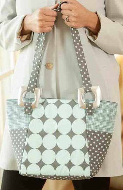 Use the center panel of this modern tote as the perfect canvas to show off your creative side