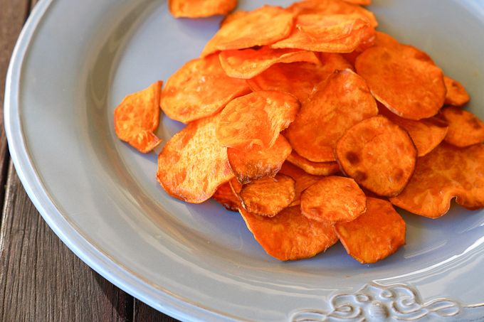 Sweet Potato Crisps - I Quit Sugar, I modified this a bit using no oil, sprinkling turmeric on them and baking it. Is sooo good