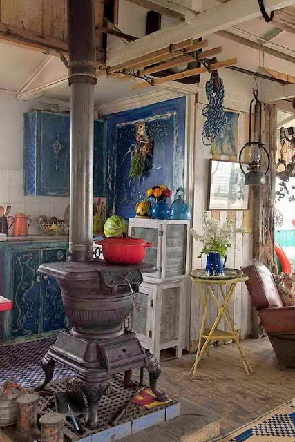 Love the blue cabinets.  Nice, old potbelly stove as well.