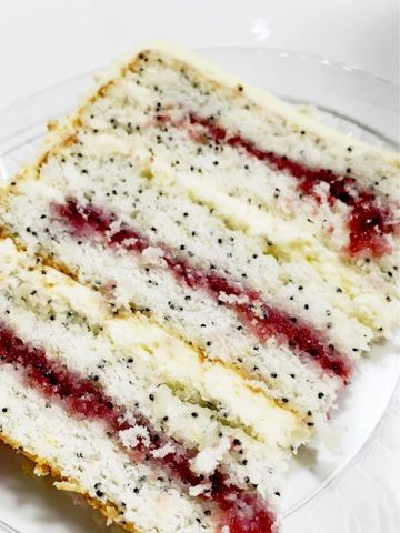 Lemon poppy seed cake layers with lemon cream cheese frosting and raspberry filling. Hi! I'm back home for a couple days before…
