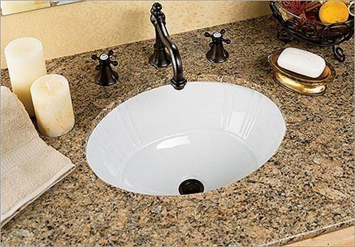 porcelain undermount bathroom sink with granite counter
