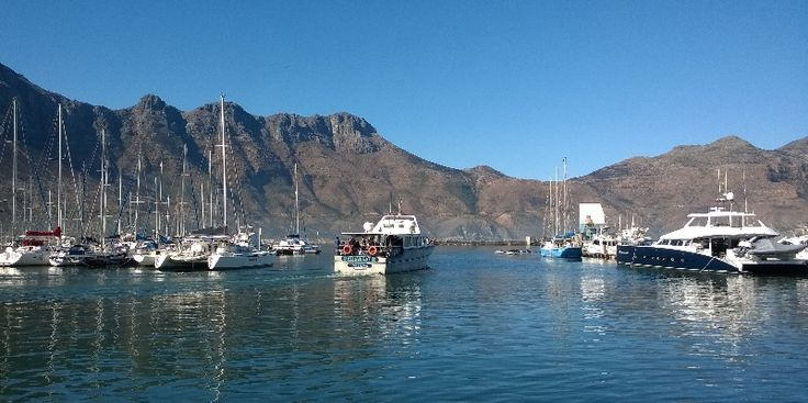 Tourist boat leaving the harbour at Hout Bay, Cape Town