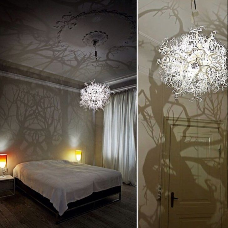 """Created by Thyra Hilden and Pio Diaz, """"Forms of Nature"""" chandelier is a beautifully designed bundle of white tangled branches, casting shadows on the walls that look like an eerie forest. As the light bulb is placed in the center of the chandelier, it projects a 360 degree shadow formation on every wall and the ceiling. """"The shadows engulf the room and transform the walls into unruly shadows of branches, bushes and gnarled trees. Mirrorings are thrown out upon the walls and ceilings and…"""