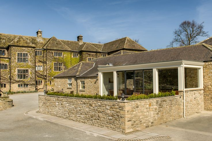 The Stable Lounge at Headlam Hall has fabulous views and sliding doors that open on to a spacious terrace area.