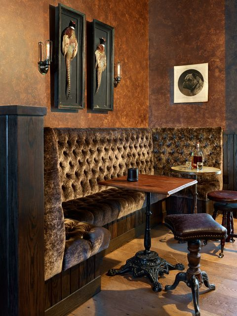 The bar area adjacent to Tasting Room channels a storied speakeasy vibe. The mix of Victorian piano stools and Victorian pub tables adds a sense of authentic character, and Wick's custom-designed wall sconces complete the theme.