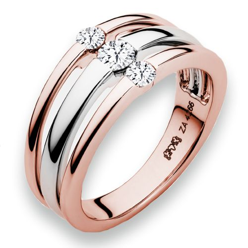 Naledi Luna Right Hand Ring - Two rows of 14kt rose gold sit on either side of a 14kt white gold band. Each is set with a small round diamond to create a petite and pretty ring.