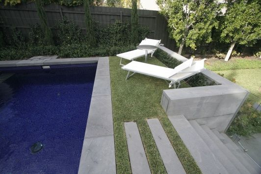 Eco Outdoor - Flooring - Bluestone with rebated and square edge coping used for pool and stairway.