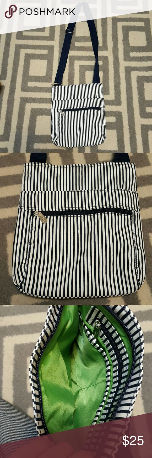 Thirty One crossbody bag Thirty One crossbody, navy blue and white stripes, brand new never used, excellent condition, comes from a smoke free home. Thirty One Bags Crossbody Bags