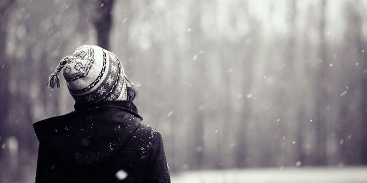 girl walking in the snow, black and white, winter photo shoot ideas