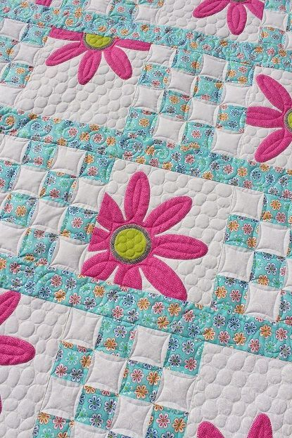 This is Lorna's Doo Da Daisy quilt and the pattern is by Amy Bradley. This is the first of two she brought me and I have the second one on my machine right now. One is pink flowers with a purple back
