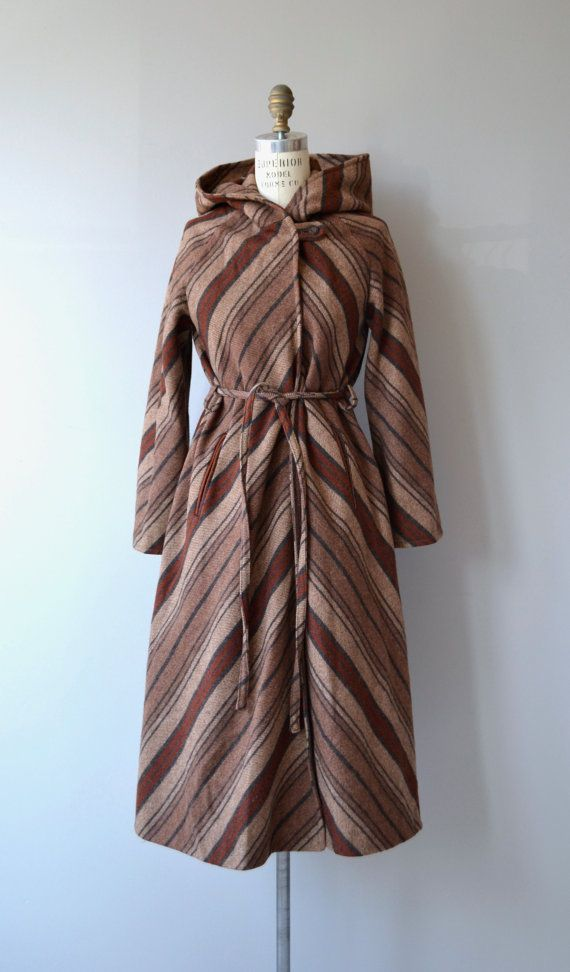 Fantastic 1970s chevron striped wool blanket coat with attached hood, one button closure under the collar, tie belt, welt pockets and espresso satin lining.  --- M E A S U R E M E N T S ---  fits like: small shoulder: raglan seam bust: up to 37 waist: ties to fit hip: free sleeve inseam: 14 shoulder to cuff (cuff is adjustable in width): approx. 21 length: 44 brand/maker: n/a condition: excellent  ✩ layaway is available for this item  ➸ More vintage coats…