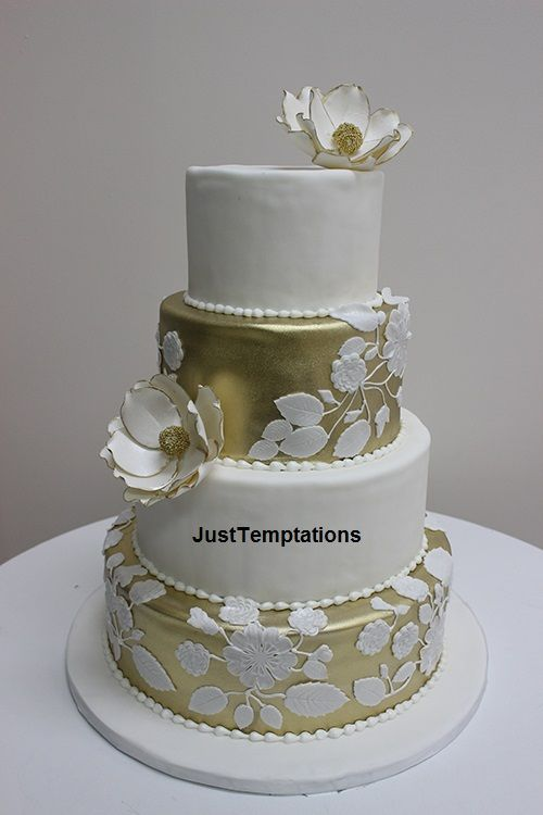 We specialize in Custom Wedding Cakes but also offer Traditional Wedding Cakes, Contemporary Wedding Cakes, Modern Wedding Cakes, Funky Wedding Cakes, Whimsical Wedding Cakes, Cupcake Wedding Cakes, Simple Wedding Cakes, Fondant Wedding Cakes, Butter Cream Wedding Cakes, Water Fountain Wedding Cakes, Chocolate Fondant Wedding Cake, Chocolate Ganache Wedding Cakes, White Chocolate, Seashell Wedding Cakes, Sugar Flower Wedding Cakes, Wedding Cakes with Fresh Flowers