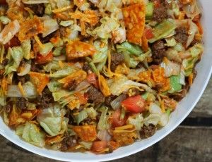 Doritos Taco Salad. Similar to my mom's recipe, but she added kidney beans and used Dorothy Lynch salad dressing.