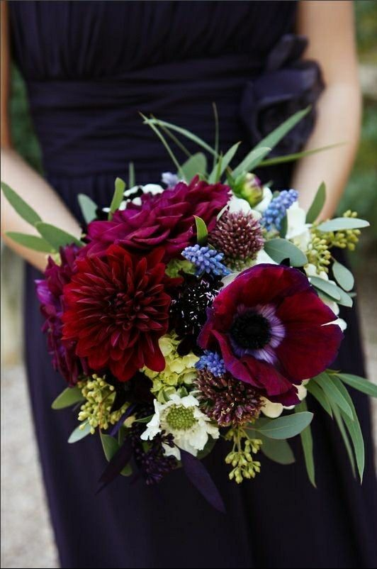 Gorgeous Bridesmaid's Bouquet Comprised Of: Red-Violet Anemones, Marsala Dahlias, Burgundy Scabiosa, White/Green Scabiosa, Green Hydrangea, Blue Muscari Hyacinth, Additional White Florals + Greenery and Foliage Including Several Varieties Of Eucalyptus