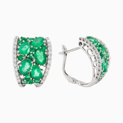 Amazing bright and luxurious earrings in 18K white gold with natural emeralds and sparkling diamonds with total weight 0.52 ct. It is one of those ladylike and classic pieces you'll reach for forever.