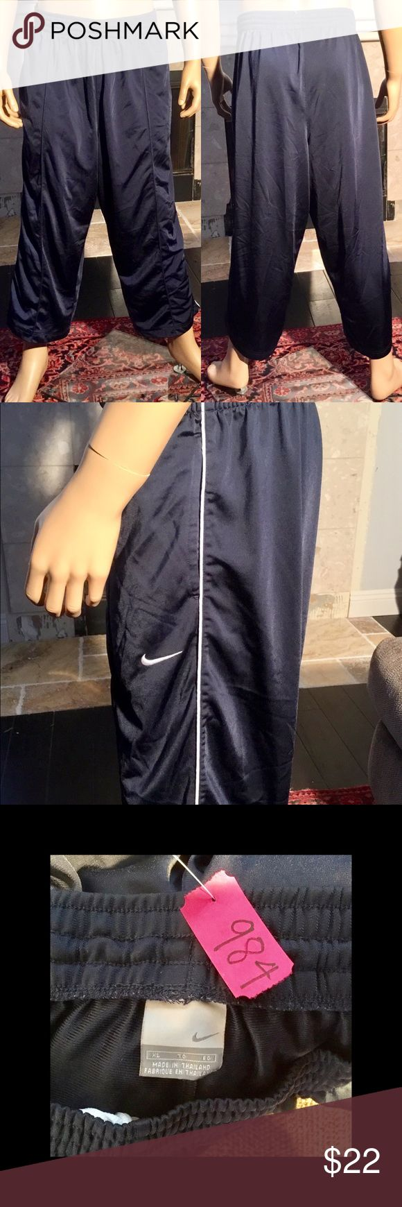 Nike Navy Blue Active Warmup Workout  Pants XL Nike Navy Blue Men's Active Warmup Workout Running Basketball Pants  Men's Size XL Approximate measurements are inseam 26, waist 18 Drawstring elastic waist Zipper at the hems In excellent used condition  From a smoke free home (984) Nike Pants Sweatpants & Joggers