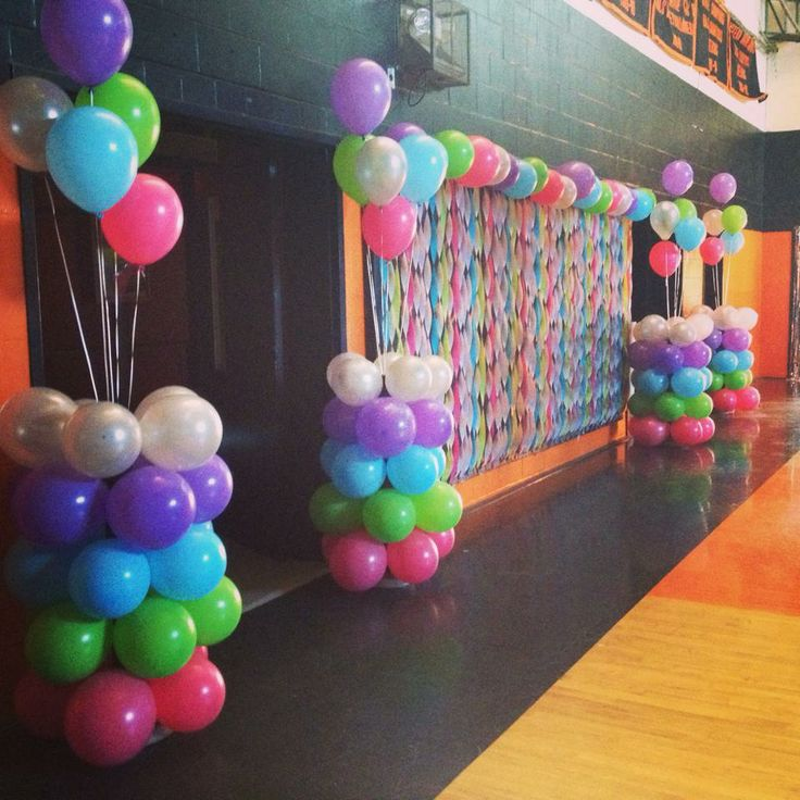 Balloon columns & decorated wall mats.