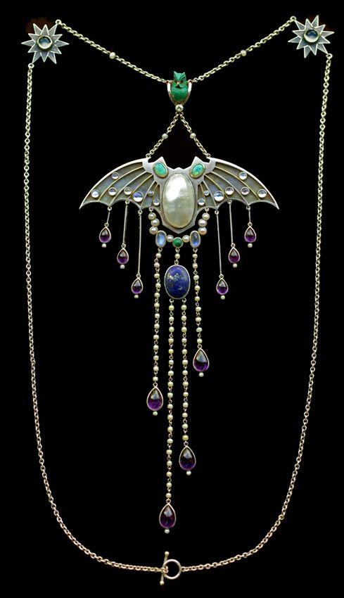 JUGENDSTIL  Superb Symbolist Bat Pendant   in the manner of GEORG KLEEMANN 1863-1932   Silver Gold  Pendant: H: 18 cm (7.09 in)  W: 8 cm (3.15 in)   Chain: L: 24 cm (9.45 in)   German, c.1910  Fitted Case  Opal, enamel, moonstone, pearl, amethyst lapis, turquoise, ruby & diamond