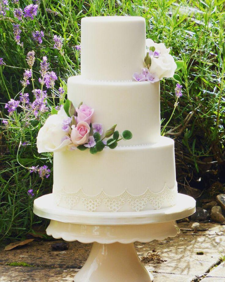 Ivory, lace and roses. Beautiful Summer Wedding Cake
