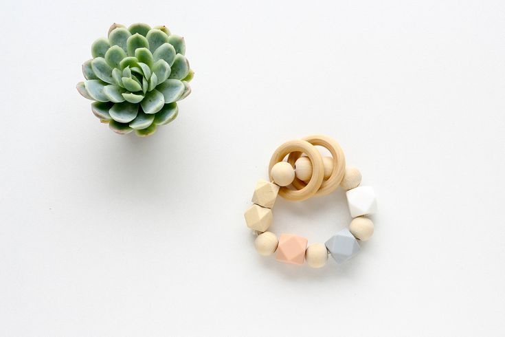 Silicone & Wooden Teething Toy Silicone Teether, Baby Teething Ring Wood and Peach silicone beads  The ever-changing shapes and edges appeals to tiny hands and make it fun for your little to follow.