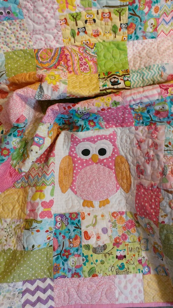 """Handmade scrappy owl quilt in shades of pink for a little girls nursery.    Ready to ship    36"""" by 44"""" baby or toddler size .    This is a"""