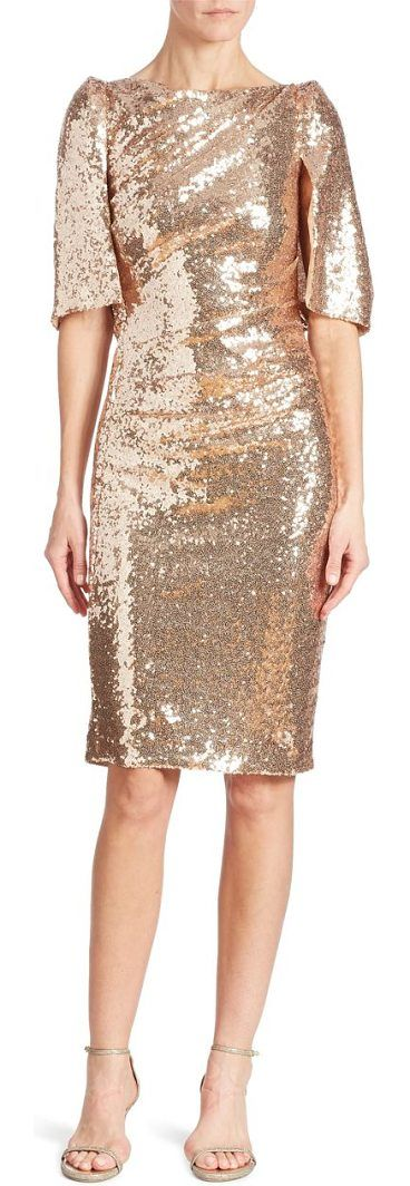 sequin cape dress by Talbot Runhof. Glamorous sequin embellished dress in a cape design. Boatneck. Cape sleeves. Concealed back zip closure. Fully lined....