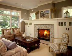 Love the built-ins and the fireplace. A cozy room.