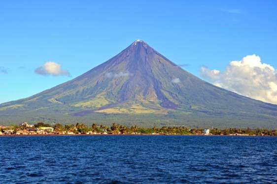 MAYON, PHILIPPINES The Mayon volcano is frequently erupting. It produces extreme lava flows that travel far down the flanks. Frequent eruptions produce mud flows and ash falls that require all residents to evacuate. Lowland areas have been destroyed by eruptions.