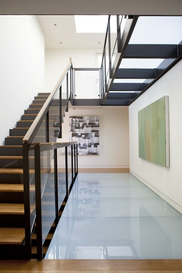 The use of the glass floor mezzanine level in the church not only poured more light into the property, it also created a 'sky lounge' for Neil & Jackie.  Here's another example of how a glass floor can make the most of the use of light in a property