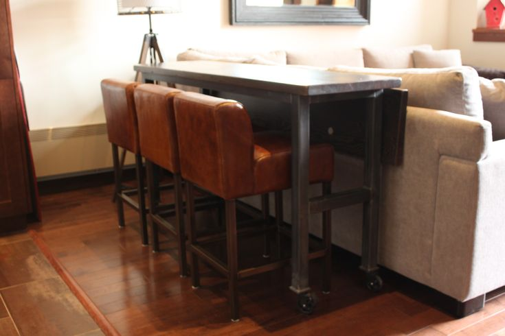 Moveable custom made wood table with coasters and fold down leaf. We can create custom tables for any size space. Contact us today.