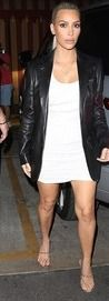 The 37-year-old walked into her late father's favorite restaurant hand-in-hand with husband of three years Kanye West, as Kris Jenner,Kourtney Kardashianand Kendall followed closely behind.