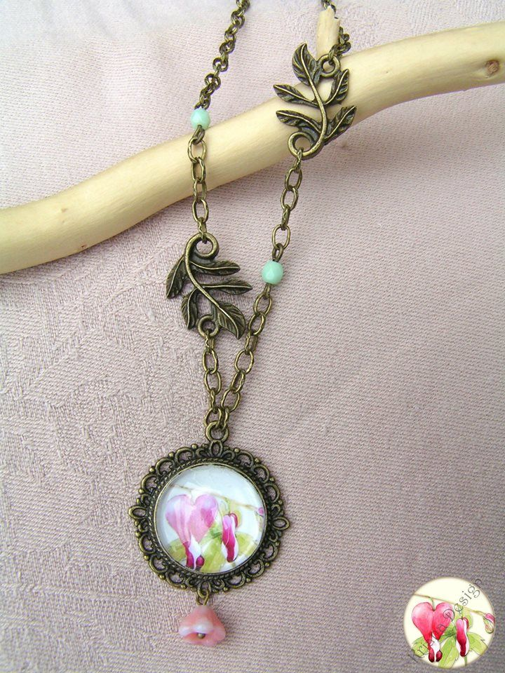 Lamprocapnos  -    The pendant diameter: 3 cm, The necklace length: 50 cm. Hanging glass flower is 8mm, the bronze leaves length is 2 cm.