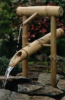 Japanese tipping fountain that is meant to scare off deer with its clicking soundOdoshi Fountain, Water Fountain, Gardens Inspiration, Shishi Odoshi, Japan Fountain Gardens, Fountain Thumbnail, Shishiodoshi, Japanese Fountain, Bamboo Fountain