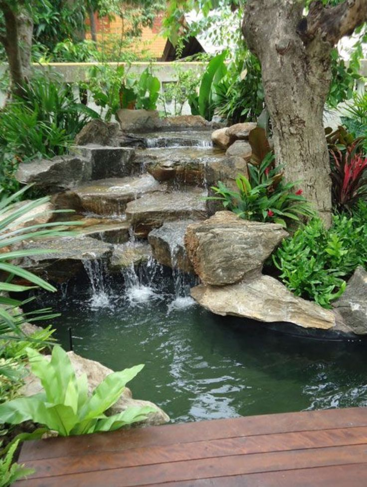 1000 images about backyard waterfalls and streams on for Yard ponds and waterfalls