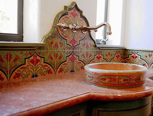 spanish tile backsplash half wall counter and basin