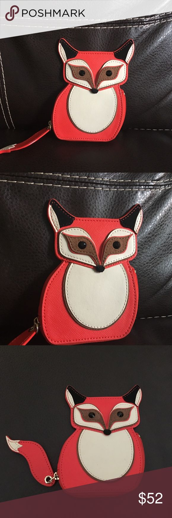 "Blaze a trail Fox coin purse 🦊 I'm selling a Kate Spade ""blaze a trail"" coin purse. I purchased this and although I love it, realized it's not practical for me. It's been used a few times. There are three small ink stains on the front as shown in picture #3. It's a beautiful coin purse to add to any collection. The price is FIRM. Please ask any questions before purchase or for additional pictures! kate spade Bags"