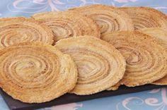 Paul's Arlettes ~ delicate French biscuit/cookie from laminated dough rolled with cinnamon-sugar spirals | recipe by Paul Hollywood, as seen on GBBO s6e2 technical challenge | via TheGreatBritishBakeOff.co.uk
